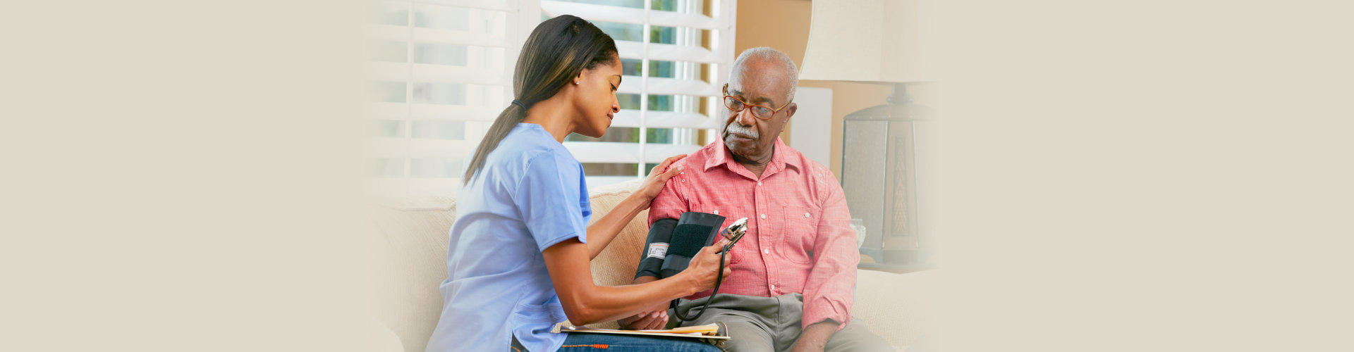 caregiver checking the health of her elderly man